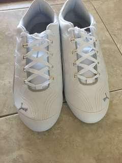 Brand new white pumas