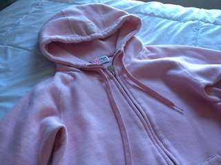 light pink TNA zip up hoodie