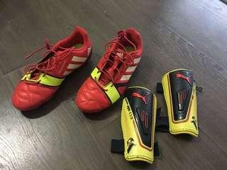 Kids Adidas soccer boots and Puma shin-guard