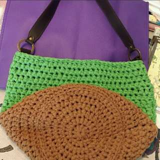 Crochet bucket bag with leather strap