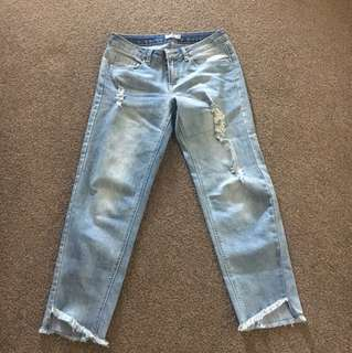 Low rise ripped boyfriend cut jeans