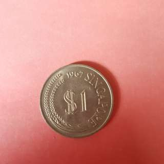 First Series 1967 $1 dollar coin