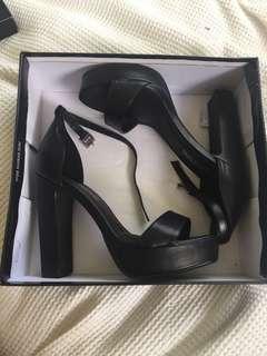 Black PLT platform heels