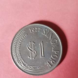 First Series 1977 $1 dollar coin