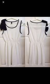 White and black dress with bow