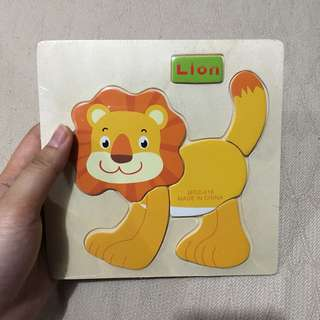 Wooden lion puzzle