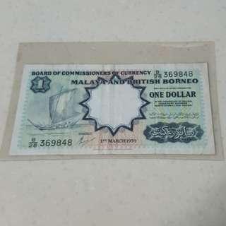 1959 Malaya and British Borneo $1 VF condition.
