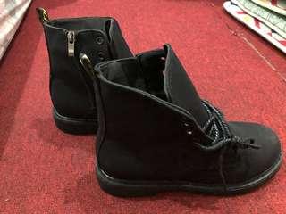 Black flat combat boots