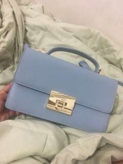 Baby blue luggage bag