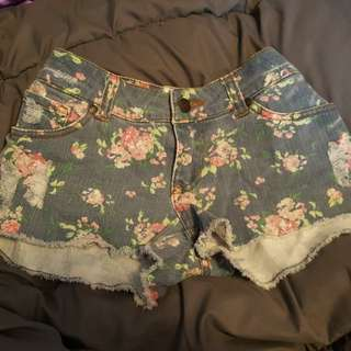 Light blue distressed floral jean shorts