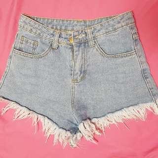 Frayed distressed denim shorts
