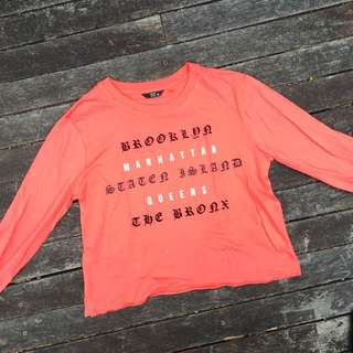 Orange long sleeve crop