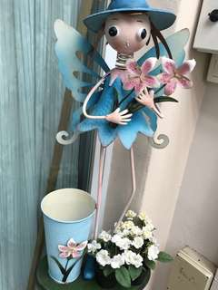 Blue butterfly /fairy carrying lilies