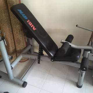 Aibi Bench with barbell racks and leg curls rack