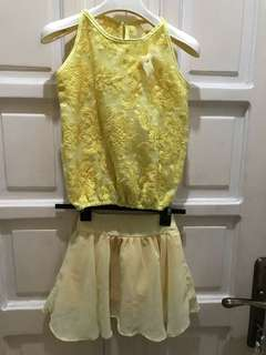 Yellow Sleeveless Blouse abd Skirt