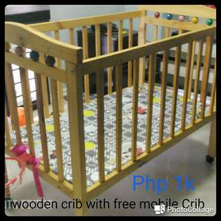 Wooden Crib with free mobile crib