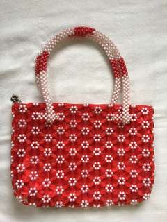 beaded red bag