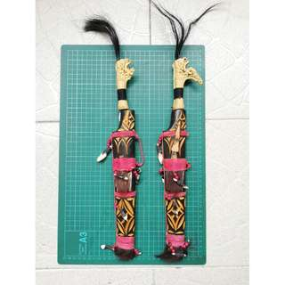 Traditional Sarawak short blade with decorated hilt and sheath