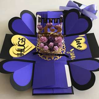 Explosion box with cake , 8 waterfall in purple , black and gold