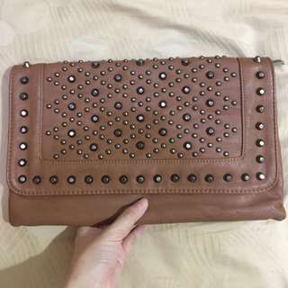 Brown studded clutch