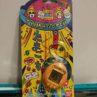 BRAND NEW AND NEVER USED! 1996 Bandai P1 Virtual Pet Tamagotchi (Orange)