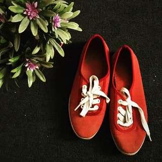 Red kicks sneakers