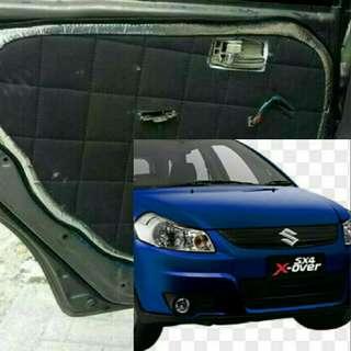 peredam suara dan pelindung pintu mobil Suzuki X - Over