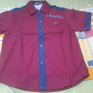 Brandnew Maroon Polo with pocket 10yrs. Old see tag for original price..selling 350