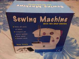 Mini Sewing Machine with two speed control.