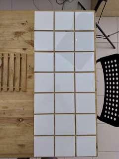 21 plain white ceramic tiles