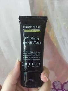 Shills peel of black mask