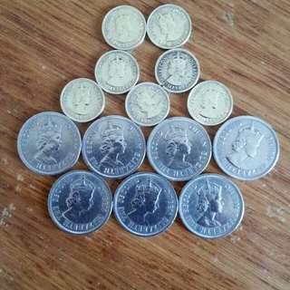 香港硬幣女皇頭👉 全部 一九六三年銀色五毫子:7個👉63年五仙:叫斗零7個🖐共14個