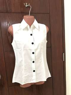 Sleeveless button down blouse
