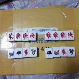 Magnetic mahjong tiles for automatic mahjong table