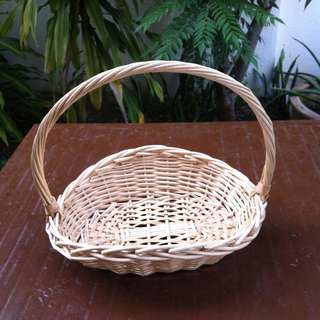 Medium size rattan basket.  In good condition.
