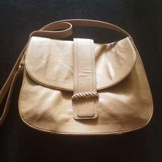 Nude sling bag