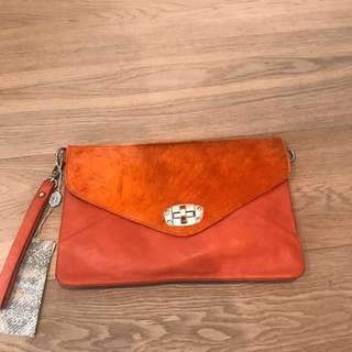 brand new clutch with shoulder strap