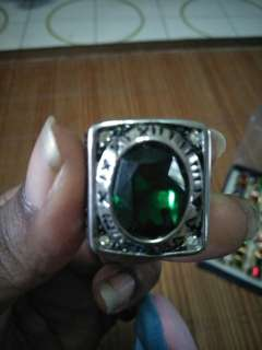 Green sinner ring