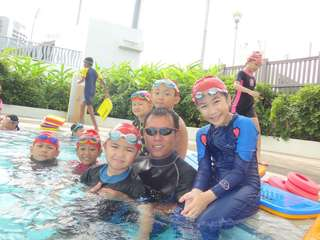 Kids group swimming lessons at Sengkang Swimming Complex on Sunday Am