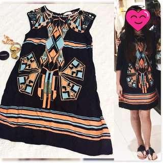 Black, blue, orange dress