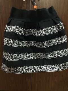 Formal mid-knee skirt
