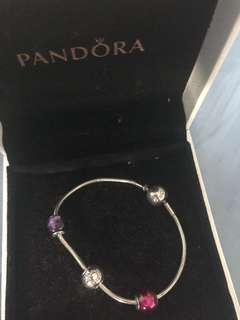 Pandora essence bracelet with passion, faith and Leo charms
