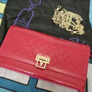 Valentino Rudy pink clutch