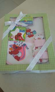 Brand new Sesame street 4 pieces Baby gift set for 0+ months selling for  $12