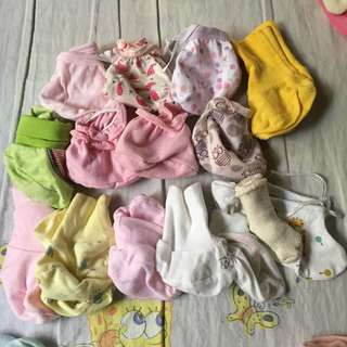 15 sets of booties and socks