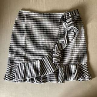 Checkered & ruffled front-tie skort with zipper back closure