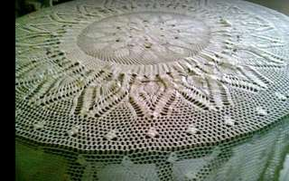 Crotchet hand made table cloth.
