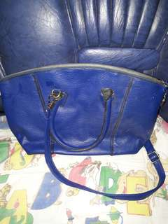 Hand with sling bag
