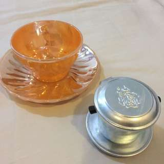 vintage tea cup and vietnamese coffee cup