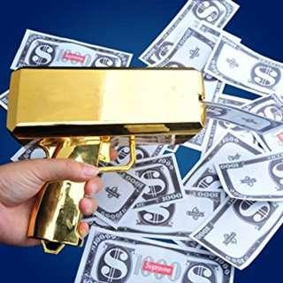 Gold cash gun
